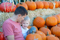 Family of two at pumpkin patch Royalty Free Stock Photo