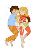 Family with two small children sleeping together Royalty Free Stock Photo