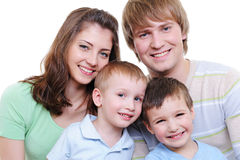 Family with two sons. Attractive portrait of young happy family with two sons - white background Royalty Free Stock Photography