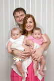 Family with  two tiny babies twin Stock Photos