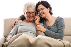 Family two women talking mobile phone having fun Royalty Free Stock Image