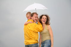 Family with the umbrella. Family with the white umbrella Royalty Free Stock Image