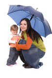 Family with umbrella Royalty Free Stock Photography