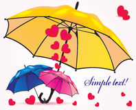 A family of umbrellas sheltering little umbrellas Royalty Free Stock Image