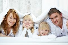 Family under blanket Stock Image