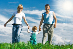 Family under blue sky Royalty Free Stock Image