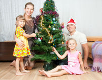 Family under the Christmas spruce Stock Image