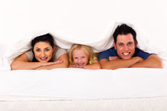 Family under duvet Royalty Free Stock Images