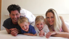 Family under duvet look into  Royalty Free Stock Photo