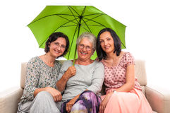 Family protection women green umbrella Royalty Free Stock Photos