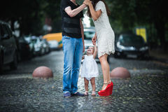Family under the rain Stock Images