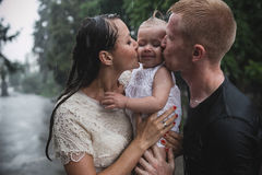 Family under the rain Stock Image