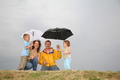Family under umbrellas Royalty Free Stock Photography