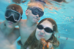 Family underwater pool. Family with child in underwater pool Royalty Free Stock Photo
