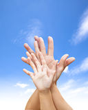 Family united hands with blue sky and cloud Stock Images