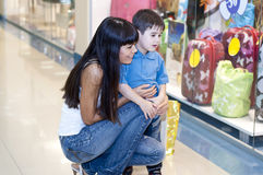 Family in universal store. Mum and the son discuss purchases in shopping center Stock Images