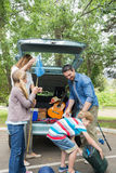 Family unloading car trunk while on picnic Stock Image