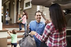 Family Unloading Shopping Bags From Car stock images