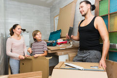 Family unpack boxes Stock Image