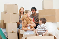 Family unpacking boxes after move in Royalty Free Stock Photo