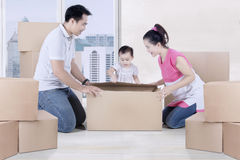 Family unpacking boxes in the new apartment Stock Photo