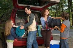 Family unpacking car Stock Image
