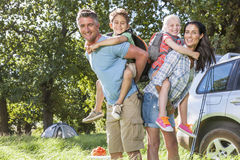 Family Unpacking Car On Camping Trip Stock Images