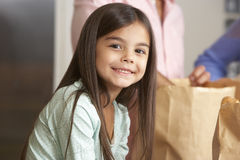 Family Unpacking Grocery Shopping In Kitchen Royalty Free Stock Photos