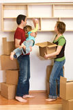 Family unpacking with lots of cardboard boxes Royalty Free Stock Photo