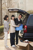 Family unpacking minivan for college, Beijing Stock Image