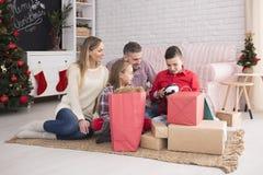 Family unpacking presents Royalty Free Stock Photo