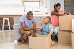 Family unwrapping things in new home Royalty Free Stock Photography