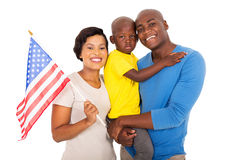 Family USA flag. Portrait of young african american family with a USA flag royalty free stock photos
