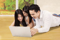 Family use laptop on the floor at house Stock Images