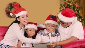 Family use tablet computer on Christmas day
