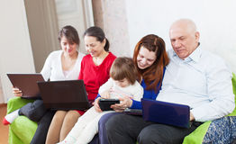 Family uses few electronic devices Royalty Free Stock Image