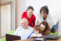 Family uses few various  devices Stock Image