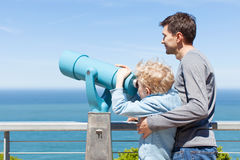 Family using binoculars Stock Image