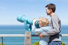 Family using binoculars Stock Image