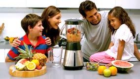 Family using a blender together