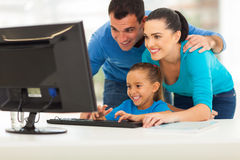 Family using computer. Happy modern family using computer together at home stock images