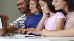 Family using computer together. At home stock footage