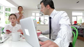 Family Using Digital Devices At Breakfast Table stock footage