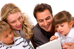 Family using digital tablet. In a white background Royalty Free Stock Image