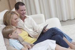 Family Using Digital Tablet Stock Image