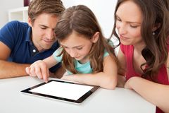 Family using digital tablet with blank screen Stock Image