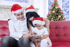 Family using digital tablet in christmas day Stock Image