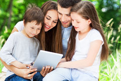 Family using digital tablet Royalty Free Stock Photo