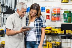 Family Using Digital Tablet In Hardware Shop Stock Photography