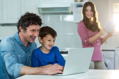 Family using digital tablet and laptop Royalty Free Stock Photography